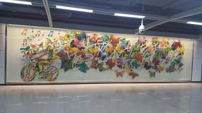 Ladderman & Butterflies in the Shenzhen Hongling subway station – China